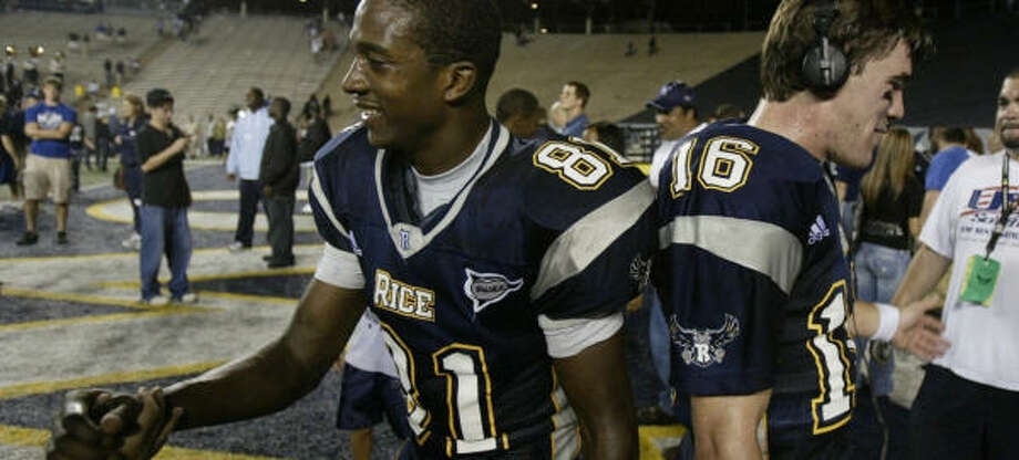 Rice players Jarett Dillard, left, and Chase Clement are getting familiar with celebrating wins. Photo: Nick De La Torre, HOUSTON CHRONICLE