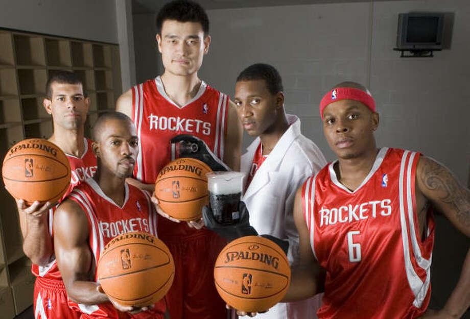 The Rockets hope Yao Ming, Tracy McGrady, Bonzi Wells, Rafer Alston and Shane Battier will be the right mix. Photo: BRETT COOMER, CHRONICLE