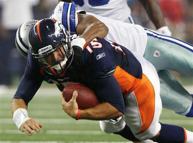 Denver Broncos quarterback Tim Tebow is tackled by Dallas Cowboys linebacker Victor Butler during the second quarter of a preseason NFL football game Thursday, Aug. 11, 2011, in Arlington, Texas. (AP Photo/LM Otero) Photo: LM Otero, Associated Press / AP