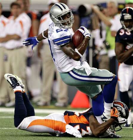 Dallas Cowboys safety Akwasi Owusu-Ansah, top, breaks a tackle by Denver Broncos cornerback Perrish Cox during the second quarter of a preseason NFL football game on Thursday, Aug. 11, 2011, in Arlington, Texas. (AP Photo/Tony Gutierrez) Photo: Tony Gutierrez, Associated Press / AP
