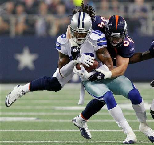 Denver Broncos safety Kyle McCarthy, right, tackles Dallas Cowboys wide receiver Jesse Holley during the second half of a preseason NFL football game on Thursday, Aug. 11, 2011, in Arlington, Texas. (AP Photo/LM Otero) Photo: LM Otero, Associated Press / AP