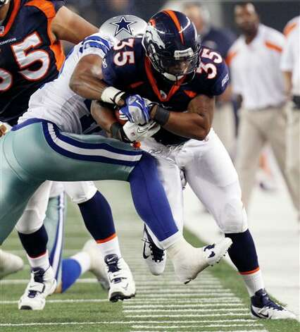Denver Broncos running back Lance Ball is driven out of bounds by Dallas Cowboys safety Barry Church during the second quartera preseason NFL football game Thursday, Aug. 11, 2011, in Arlington, Texas. (AP Photo/LM Otero) Photo: LM Otero, Associated Press / AP