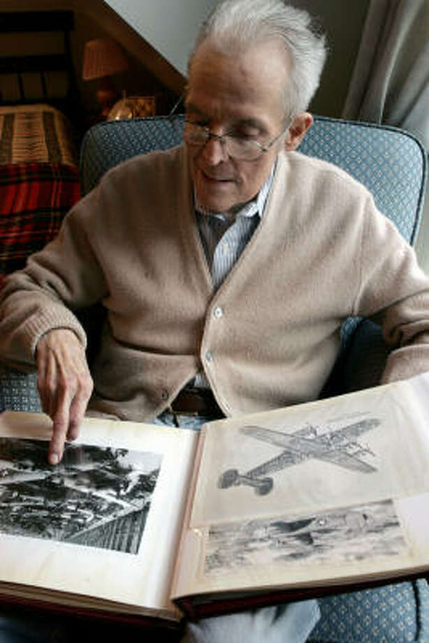 Warren Ludlum, 83, looks through his scrapbook of B-24 bomber memorabilia Friday. Ludlum made clear that he has great respect for the Tuskegee Airmen and liked being escorted by them because of their aggressiveness. Photo: Mel Evans, AP