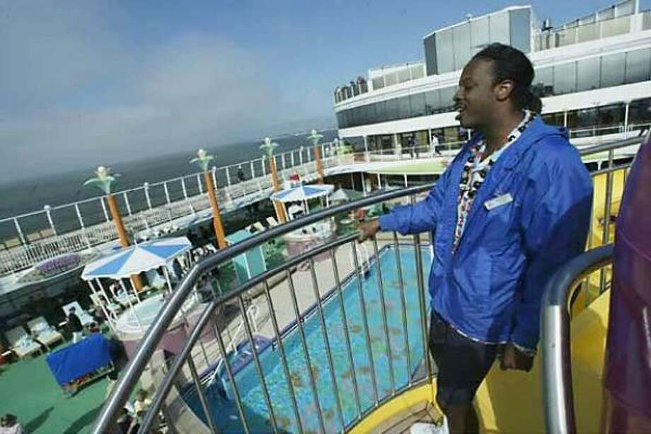DJ by night, pool slide attendant by day: Michael, part of the all-American crew on Pride of Hawaii, wears multiple hats. Photo: Spud Hilton, San Francisco Chronicle