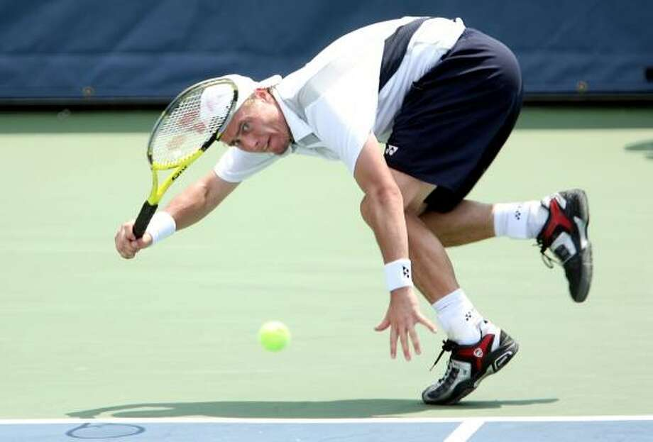 Lleyton Hewitt lunges for a ball during his match against Arnaud Clement on day 5 of the Legg Mason Tennis Classic on Friday. Photo: Jamie Squire, Getty Images