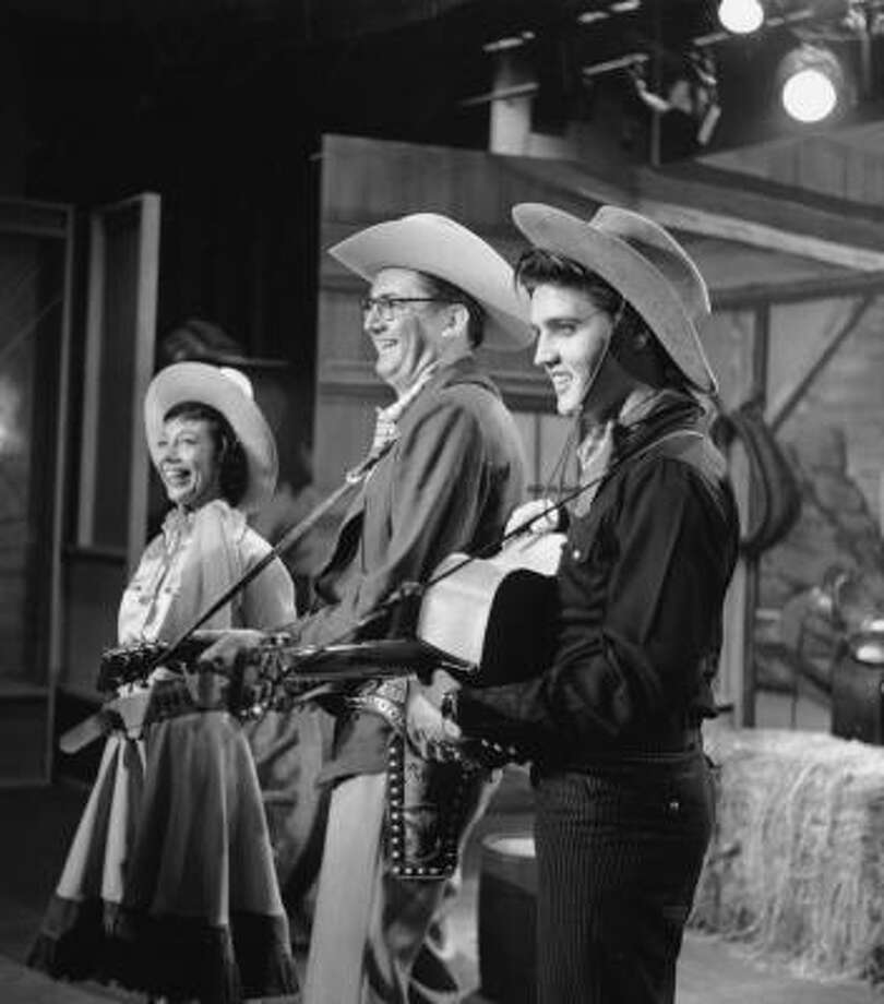 Singer Elvis Presley is shown performing on The Steve Allen Show in New York, in this July 1956 photo. At center is Steve Allen, and next to him is Imogene Coca. Photo: Associated Press