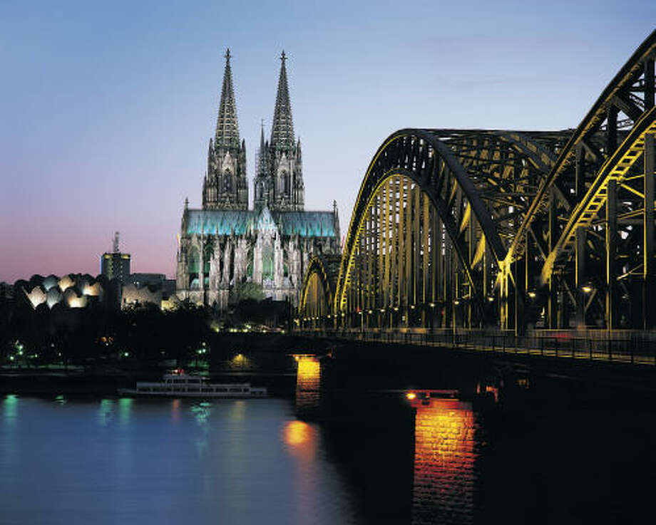 The Cologne Cathedral, the world's second-tallest Gothic structure, towers above one of Germany's liveliest cities just beyond the Hohenzollern, a much-used rail and foot bridge. Photo: Robert Harding, Getty Images