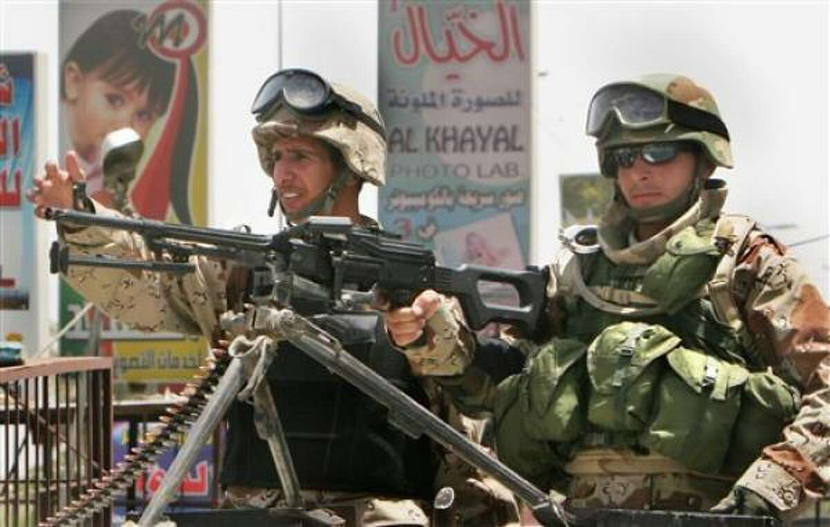 Iraqi soldiers man a checkpoint in central Baghdad today after the Iraqi capital was subjected to a vehicle ban in an effort to prevent reprisal attacks from suicide car bombs after the killing of Abu Musab al-Zarqawi.