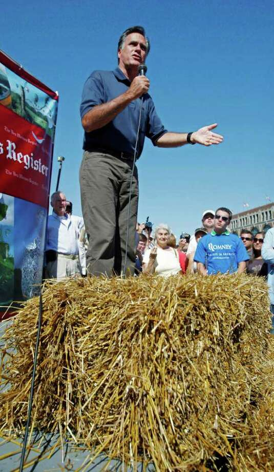 Republican presidential candidate, former Mass. Gov. Mitt Romney speaks to fair goers during a campaign stop at the Iowa State Fair in Des Moines, Iowa, Thursday, Aug. 11, 2011. (AP Photo/Charlie Neibergall) Photo: Charlie Neibergall