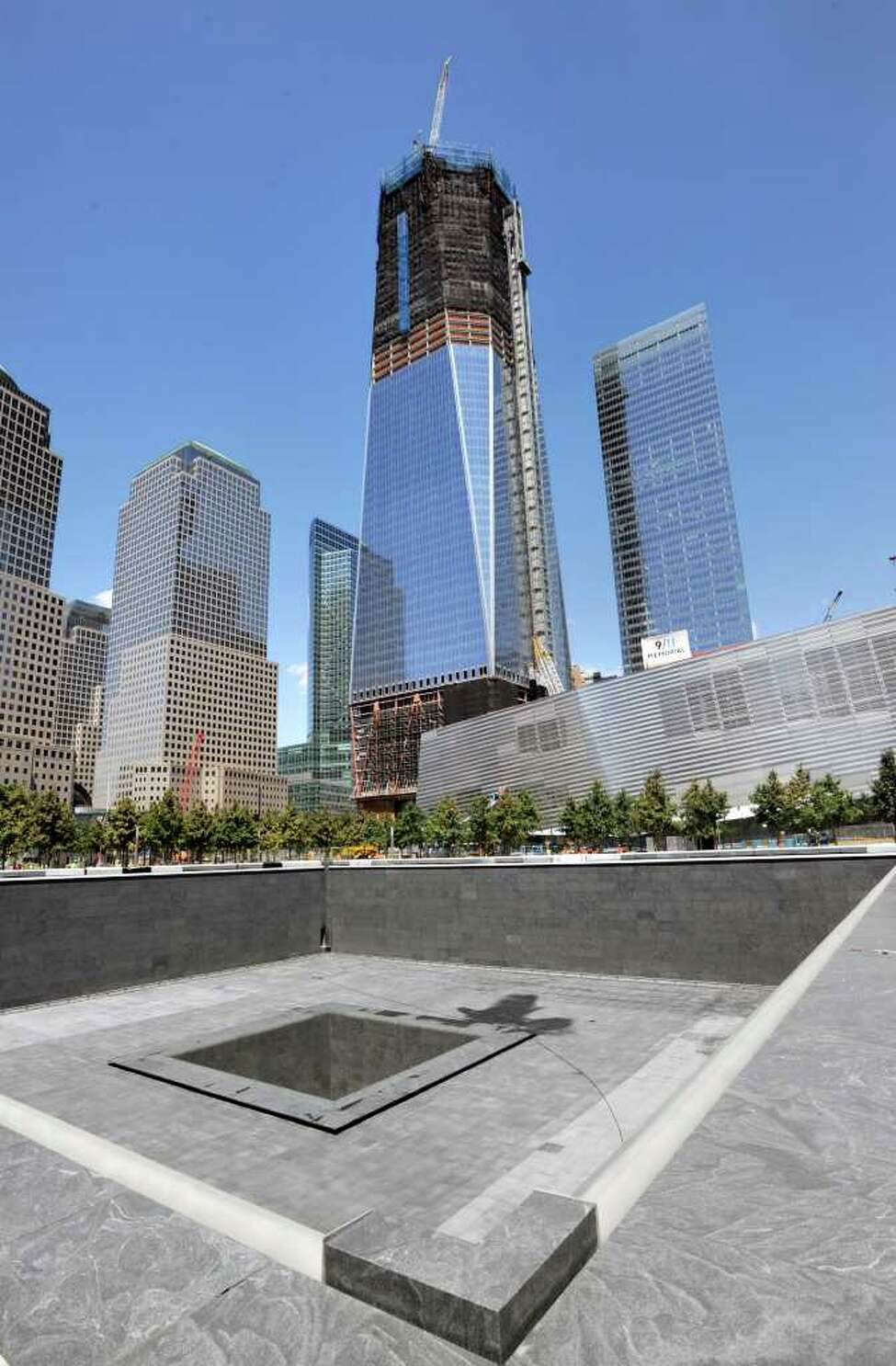 The footprint of the south tower of the World Trade Center with the Freedom Tower, also known as One World Trade Center, New York City, Thursday, Aug. 11, 2011, under construction a month before the 10th anniversary of 9/11. ( Bob Luckey / Hearst Newspapers )