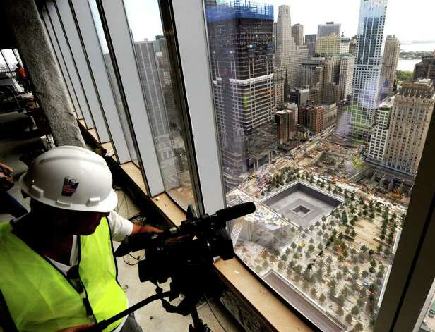 A cameraman documents the footprints of the World Trade Center towers from the 39th floor of the Freedom Tower, also known as One World Trade Center, New York City, Thursday, Aug. 11, 2011, under construction a month before the 10th anniversary of 9/11. Photo: Bob Luckey / Greenwich Time