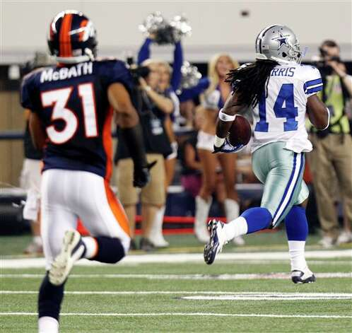 Dallas Cowboys wide receiver Dwayne Harris, right, makes a 76-yard touchdown as Denver Broncos safety Darcel McBath (31) follows during the fourth quarter of a preseason NFL football game on Thursday, Aug. 11, 2011, in Arlington, Texas. (AP Photo/LM Otero) Photo: LM Otero, Associated Press / AP