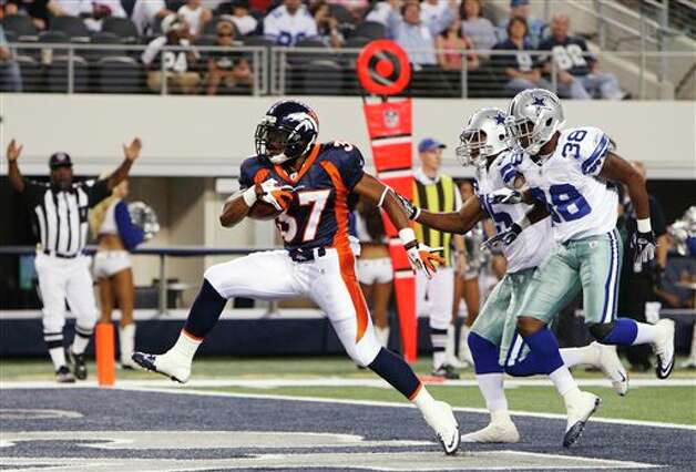 Denver Broncos running back Jeremiah Johnson scores a 13-yard touchdown as he is pursued by Dallas Cowboys cornerback Ross Weaver (25) and Dallas Cowboys cornerback Alex Ibiloye (38)during the fourth quarter of a preseason NFL football game Thursday, Aug. 11, 2011, in Arlington, Texas. (AP Photo/LM Otero) Photo: LM Otero, Associated Press / AP