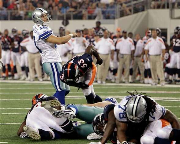 Dallas Cowboys place kicker David Buehler makes the extra point after Raymond Radway scored six-yard touchdown against the Denver Broncos during the third quarter of a preseason NFL football game Thursday, Aug. 11, 2011, in Arlington, Texas. (AP Photo/Tony Gutierrez) Photo: Tony Gutierrez, Associated Press / AP