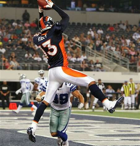 Denver Broncos wide receiver Eron Riley catches an eight-yard touchdown pass from Brady Quinn against the Dallas Cowboys during the fourth quarter of a preseason NFL football game Thursday, Aug. 11, 2011, in Arlington, Texas. (AP Photo/LM Otero) Photo: LM Otero, Associated Press / AP