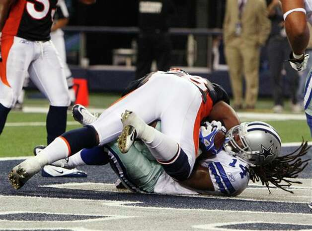 Dallas Cowboys wide receiver Dwayne Harris, bottom, scores a 13-yard touchdown as Denver Broncos linebacker Braxton Kelley makes a tackle during the fourth quarter of a preseason NFL football game Thursday, Aug. 11, 2011, in Arlington, Texas. The Cowboys won 24-23. (AP Photo/LM Otero) Photo: LM Otero, Associated Press / AP