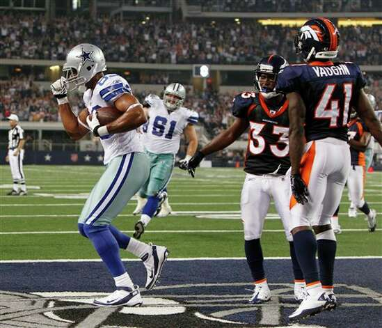 Dallas Cowboys tight end Martin Rucker makes a 2-point conversion between Denver Broncos cornerback Nate Jones (33) and Cassius Vaughn (41) during an NFL preseason football game Thursday, Aug. 11, 2011, in Arlington, Texas. The Cowboys won 24-23. (AP Photo/LM Otero) Photo: LM Otero, Associated Press / AP