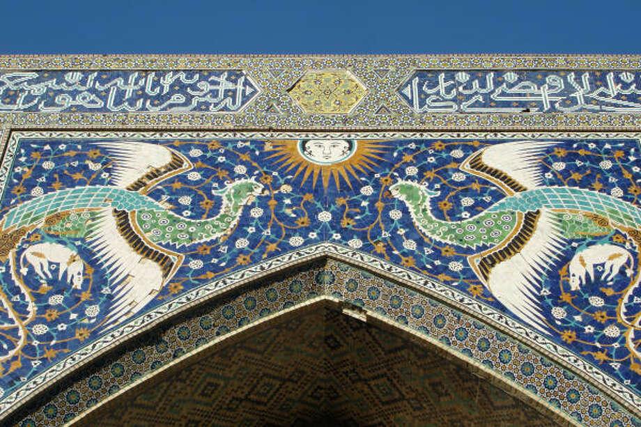 Colorful tiles adorn the elaborate gate to Bukhara's 17th century Nadir Divanbegi Madrassah. Photo: Cragg Hines, Chronicle