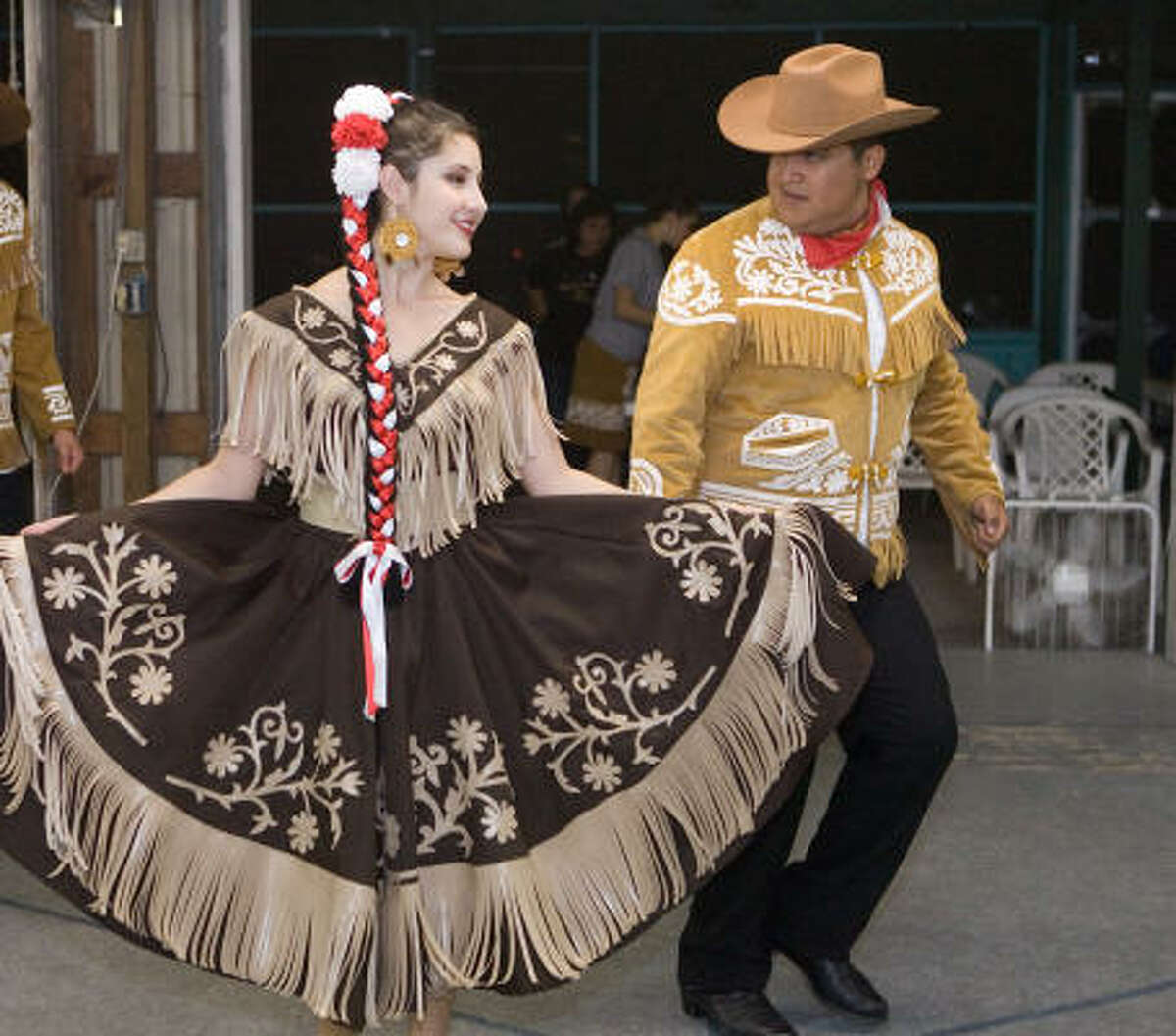 Esmerelda Salazar and Joel Mejia of Mixteco Ballet Folklorico demonstrate one of the dances that won the group a national award.