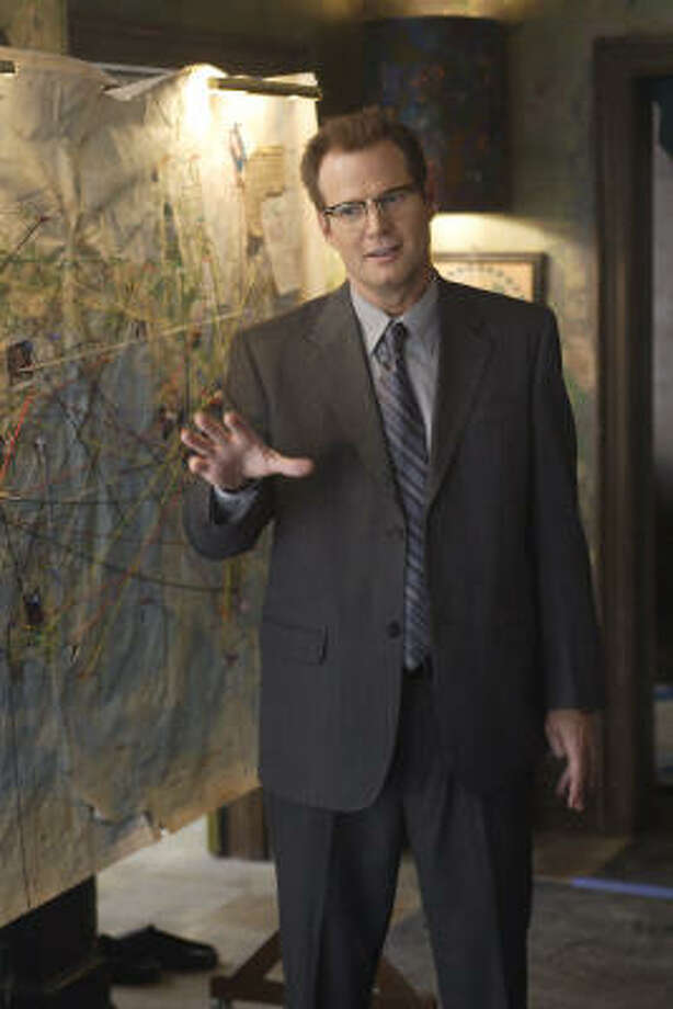 """Jack Coleman stars as the mysterious Mr. Bennett, aka """"Horn-Rimmed Glasses,"""" on NBC's Heroes. Photo: Paul Drinkwater, NBC"""