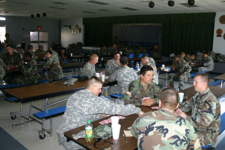 Soldiers from Fort Hood's 1st Cavalry Division relax after enjoying a spaghetti dinner in the Etoile school cafeteria after their bus broke down in East Texas in late May. Photo: JAN AMEN, For The Chronicle