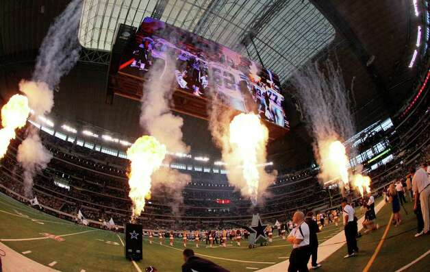The Dallas Cowboys put on a spectacle for the start of their pre-season game against the Denver Broncos at Cowboys Stadium in Arlington, Texas on Thursday, August 11, 2011.  Cowboys defeated the Broncos 24-23. Kin Man Hui/kmhui@express-news.net Photo: KIN MAN HUI, -- / San Antonio Express-News