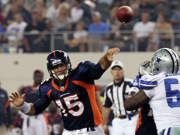 Denver Broncos' quarterback Tim Tebow launches a pass against the Dallas Cowboys in the first half of their pre-season football game at Cowboys Stadium in Arlington, Texas on Thursday, August 11, 2011.  Kin Man Hui/kmhui@express-news.net Photo: KIN MAN HUI, -- / San Antonio Express-News