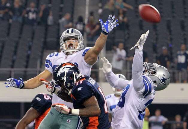 Dallas Cowboys' Andrew Sendejo (36) and Chris Randle (33) cover a last effort pass to Denver Broncos' Jamel Hamler (11) near the end of the fourth quarter to give the Cowboys a victory in their pre-season football game at Cowboys Stadium in Arlington, Texas on Thursday, August 11, 2011.  Cowboys defeated the Broncos 24-23. Kin Man Hui/kmhui@express-news.net Photo: KIN MAN HUI, -- / San Antonio Express-News