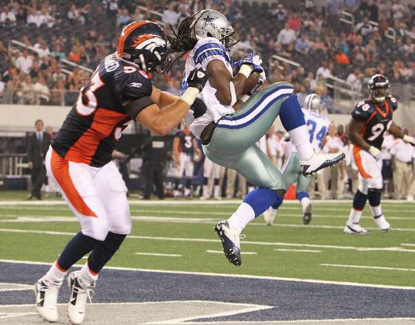 Dallas Cowboys' Dwayne Harris (right) makes a catch in the end zone against Denver Broncos' Mike Mohamed (53) late in the fourth quarter and gave the Cowboys a chance for a win in their pre-season football game at Cowboys Stadium in Arlington, Texas on Thursday, August 11, 2011.  Cowboys defeated the Broncos 24-23. Kin Man Hui/kmhui@express-news.net Photo: KIN MAN HUI, -- / San Antonio Express-News