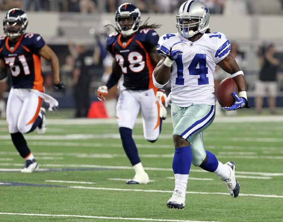 Dallas Cowboys' Dwayne Harris (14) sprints toward the end zone for a touchdown against Denver Broncos' Quinton Carter (28) and Darcel McBath (31) in the fourth quarter of their pre-season football game at Cowboys Stadium in Arlington, Texas on Thursday, August 11, 2011.  Kin Man Hui/kmhui@express-news.net Photo: KIN MAN HUI, -- / San Antonio Express-News