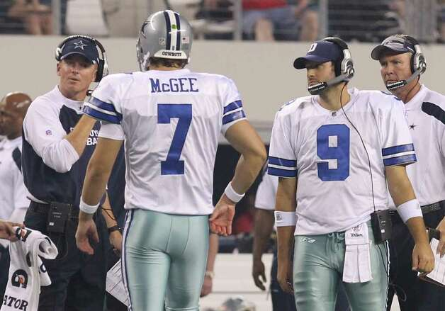 Dallas Cowboys head coach Jason Garrett (left) and starting quarterback Tony Romo (09) don the headsets as quarterback Stephen McGee takes over for a series against the Denver Broncos in the first half of their pre-season football game at Cowboys Stadium in Arlington, Texas on Thursday, August 11, 2011.  Kin Man Hui/kmhui@express-news.net Photo: KIN MAN HUI, -- / San Antonio Express-News