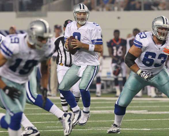 Dallas Cowboys' quarterback Tony Romo (center) looks to throw to a receiver against the Denver Broncos in the first half of their pre-season football game at Cowboys Stadium in Arlington, Texas on Thursday, August 11, 2011.  Kin Man Hui/kmhui@express-news.net Photo: KIN MAN HUI, -- / San Antonio Express-News