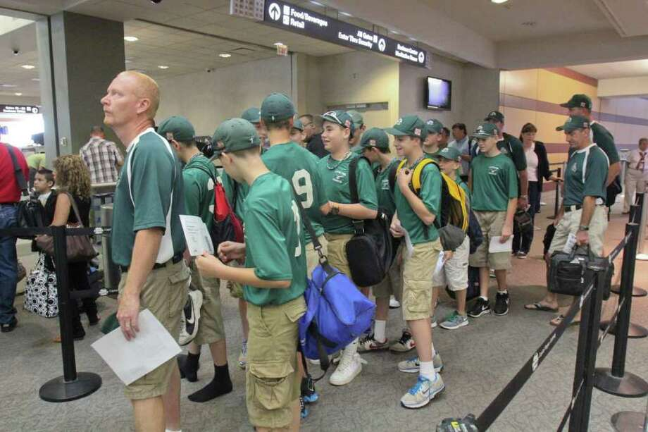 The Clifton Park Knights stand in the security check point line at the Albany International airport on Thursday, Aug. 11, 2011 to play in the Cal Ripkin World Series in Aberdeen, MD. (Erin Colligan / Special To The Times Union)