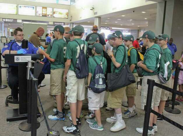 The Clifton Park Knights stand in the security check point line at the Albany International airport on Thursday, Aug. 11, 2011 to play in the Cal Ripken World Series in Aberdeen, MD. (Erin Colligan / Special To The Times Union)