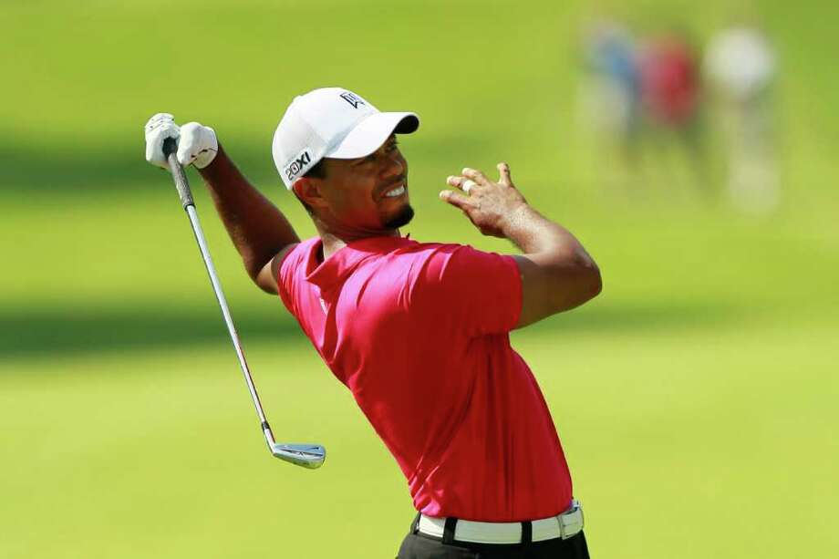 JOHNS CREEK, GA - AUGUST 11:  Tiger Woods reacts to a missed shot during the first round of the 93rd PGA Championship at the Atlanta Athletic Club on August 11, 2011 in Johns Creek, Georgia.  (Photo by Kevin C. Cox/Getty Images) Photo: Kevin C. Cox