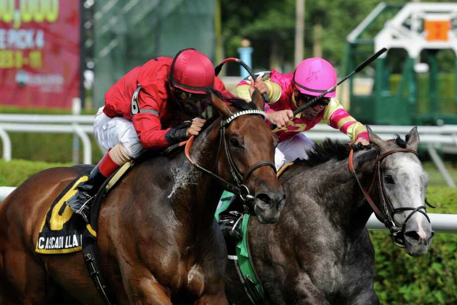 Cascadia Falls with jockey John Velazquez, left,  passes Funny Sunny with jockey Kent Desormeaux to win the Lucy Scribner Stakes on Aug. 11 at  Saratoga Race Course in Saratoga Springs. (Skip Dickstein / Times Union) Photo: SKIP DICKSTEIN