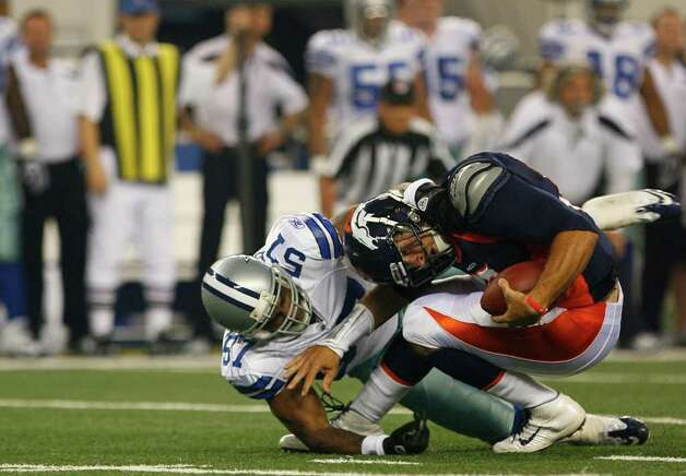 Denver Broncos quarterback Tim Tebow (15) is nearly sacked by Dallas Cowboys linebacker Victor Butler (57) during their pre-season football game Thursday August 11, 2011 at the Cowboys Stadium in Arlington, Texas.  The Cowboys won 24-23.  SALLY FINNERAN/sfinneran@express-news.net Photo: SALLY FINNERAN, -- / © SAN ANTONIO EXPRESS-NEWS