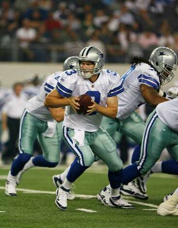 Dallas Cowboys quarterback Jon Kitna (3) brings the ball back from a snap during their pre-season football game against the Denver Broncos Thursday August 11, 2011 at the Cowboys Stadium in Arlington, Texas.  The Cowboys won 24-23.  SALLY FINNERAN/sfinneran@express-news.net Photo: SALLY FINNERAN, -- / © SAN ANTONIO EXPRESS-NEWS