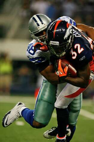 Denver Broncos cornerback Perrish Cox (32) is tackled by Dallas Cowboys linebacker Isaiah Greenhouse (48) during the second half of their pre-season football game Thursday August 11, 2011 at the Cowboys Stadium in Arlington, Texas.  The Cowboys won 24-23.  SALLY FINNERAN/sfinneran@express-news.net Photo: SALLY FINNERAN, -- / © SAN ANTONIO EXPRESS-NEWS