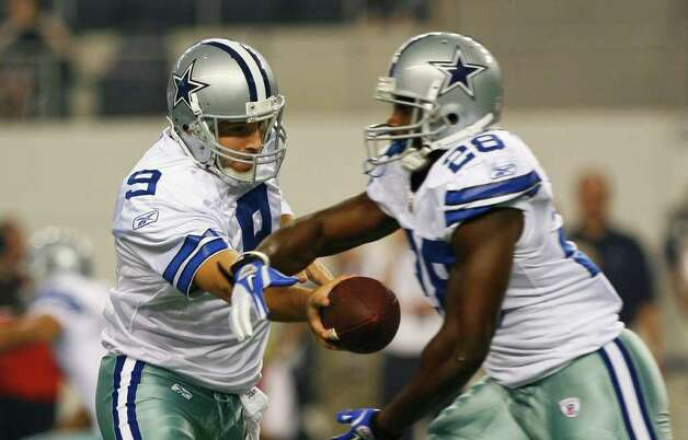 Dallas Cowboys quarterback Tony Romo (9) hands of to Dallas Cowboys running back Felix Jones (28) in the first half of their pre-season football game Thursday August 11, 2011 at the Cowboys Stadium in Arlington, Texas.  SALLY FINNERAN/sfinneran@express-news.net Photo: SALLY FINNERAN, -- / © SAN ANTONIO EXPRESS-NEWS