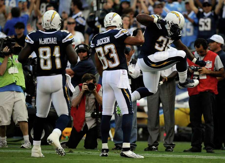 (R-L) Mike Tolbert #35 of the San Diego Chargers reacts with teammates Vincent Jackson #83 and Randy McMichael #81 after scoring on an eight-yard touchdown reception in the first quarter against the Seattle Seahawks. Photo: Kevork Djansezian, Getty Images / 2011 Getty Images