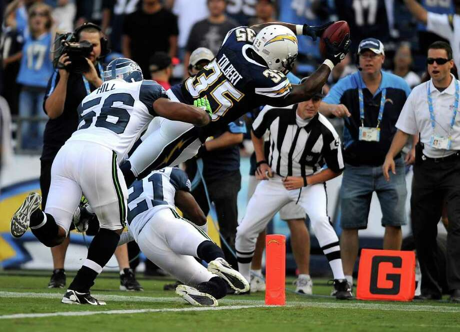 Mike Tolbert #35 of the San Diego Chargers dives into the endzone over Kelly Jennings #21 of the Seattle Seahawks to score an eight-yard touchdown reception in the first quarter. Photo: Kevork Djansezian, Getty Images / 2011 Getty Images
