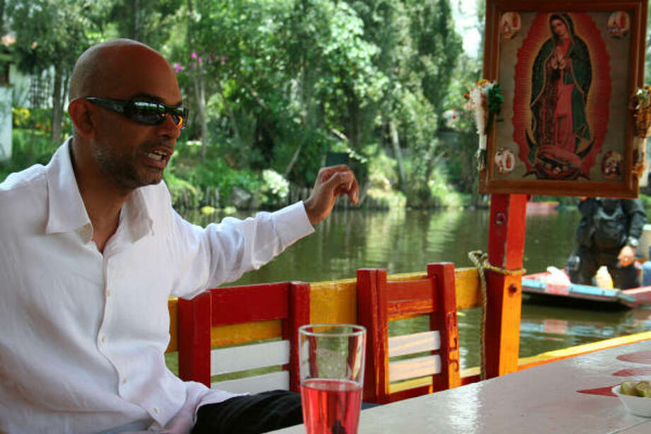 In the new film, actor Jaskarin, who portrays Karim, a devout American Muslim researching the Guadalupe image for a television script, is on a boat at the Xochimilco water gardens. Photo: Dos Corazones Films