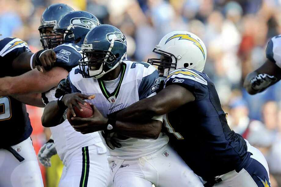 Quarterback Tarvaris Jackson #7 of the Seattle Seahawks is sacked by Ogemdi Nwagbuo #91 of the San Diego Chargers in the second quarter. Photo: Kevork Djansezian, Getty Images / 2011 Getty Images