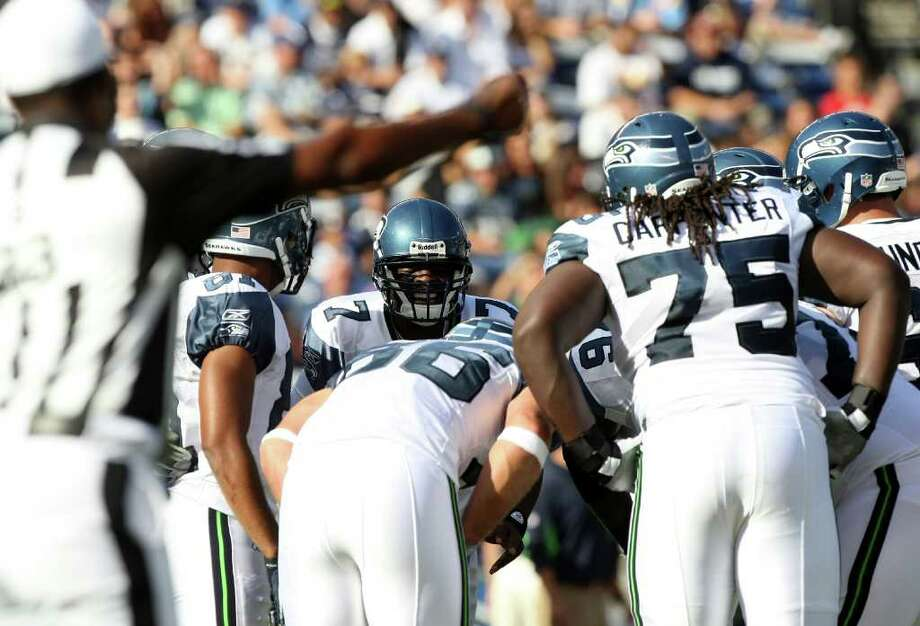 Quarterback Tarvaris Jackson #7 of  the Seattle Seahawks in the huddle against  the San Diego Chargers during their  NFL preseason game on August 11, 2011 at Qualcomm Stadium in San Diego, California. Photo: Donald Miralle, Getty Images / 2011 Getty Images