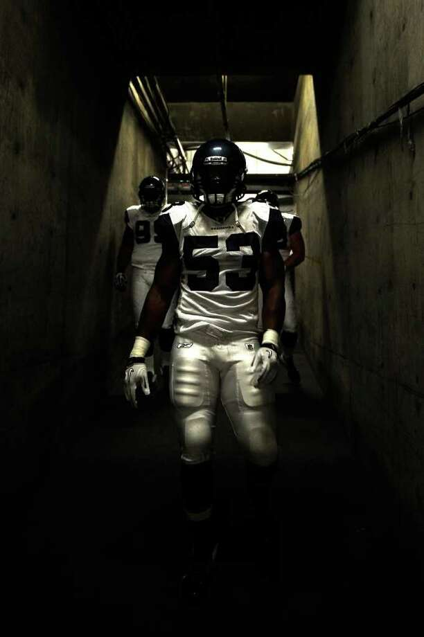 Linebacker Malcolm Smith #53 of the Seattle Seahawks stands in the tunnel before taking on the San Diego Chargers. Photo: Kevork Djansezian, Getty Images / 2011 Getty Images