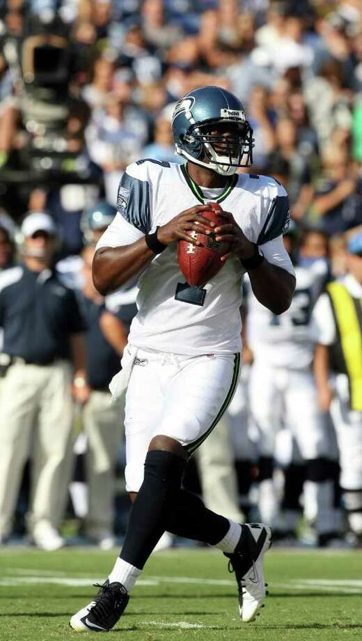 Quarterback Tarvaris Jackson #7 of  the Seattle Seahawks rolls back in the pocket against  the San Diego Chargers during their  NFL preseason game on August 11, 2011 at Qualcomm Stadium in San Diego, California. Photo: Donald Miralle, Getty Images / 2011 Getty Images