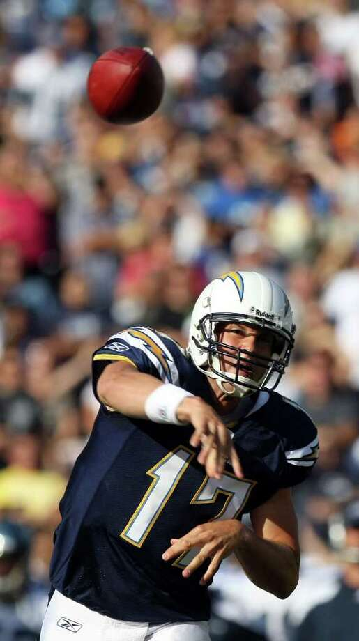 Quarterback Philip Rivers #17 of the San Diego Chargers throws the ball against the Seattle Seahawks during their  NFL preseason game on August 11, 2011 at Qualcomm Stadium in San Diego, California. Photo: Donald Miralle, Getty Images / 2011 Getty Images