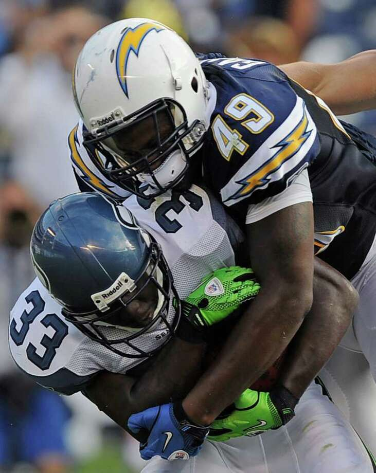 Line backer Darryl Gamble #49 of the San Diego Chargers tackles running back Leon Washington #33 of the Seattle Seahawks  in the second quarter. Photo: Kevork Djansezian, Getty Images / 2011 Getty Images