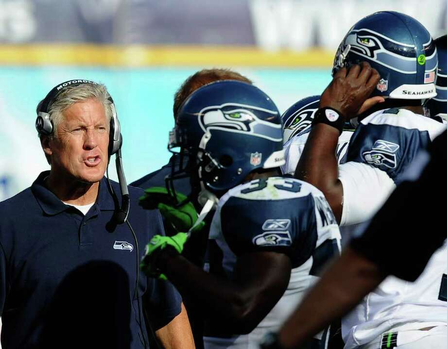 Head coach Pete Carroll of the Seattle Seahawks speaks with quarterback Tarvaris Jackson #7 after a sack during the NFL preseason gameat Qualcomm Stadium on August 11, 2011 in San Diego, California. Photo: Kevork Djansezian, Getty Images / 2011 Getty Images